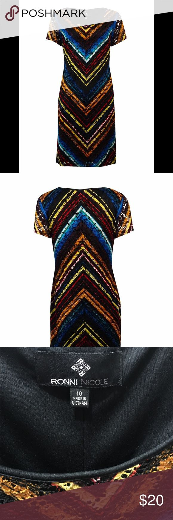 Ronni Nicole Chevron Print Lace Cap Sleeve Dress This pull over style printed chevron lace dress is from Roni Nicole. The multicolored printed lace includes red, blue, and yellow chevrons. This lovely dress is fully lined with a black lining adding modesty and function. has stretch, and is very comfortable. It travels well too; I wore it on a cruise. Pair it with sandals in summer and ankle booties and tights in winter. Looks great with turquoise jewelry too! Smoke-free, dog friendly home…