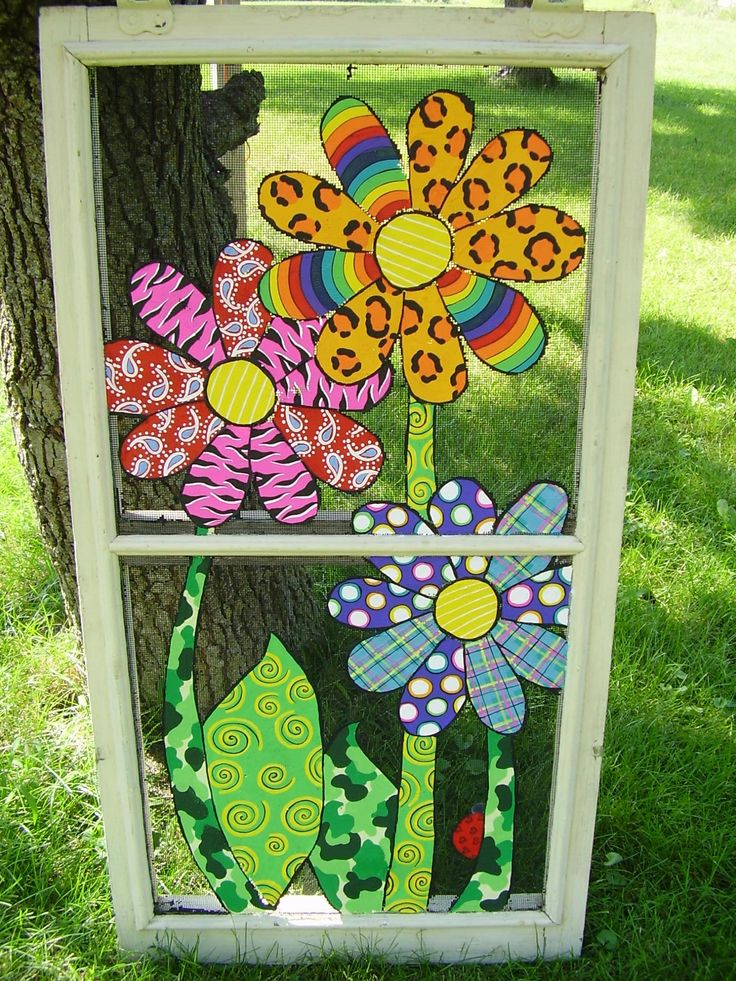 Daisies on an old window screen