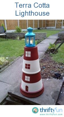 sandylandya@outlook.es  This terracotta lighthouse is just 2 large plant pots cemented together and painted, with a lantern on top.