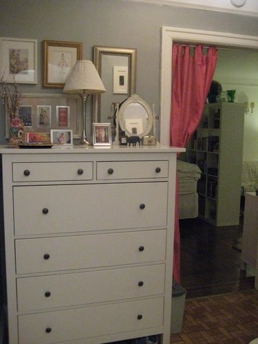 tall white dresser, black knobs