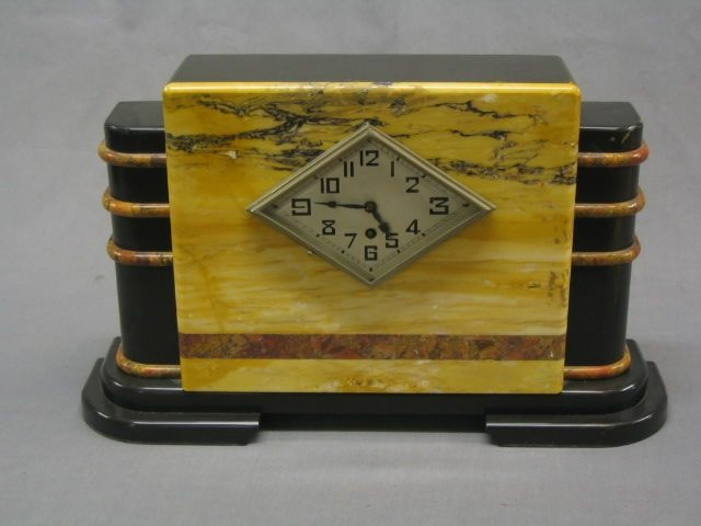 An 8 day Art Deco mantel clock contained in a 3 color marble case