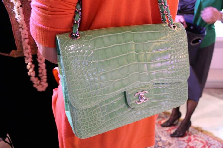 Chanel bags 2014 new spring line. The blonde in the pic. The gator bags are back.