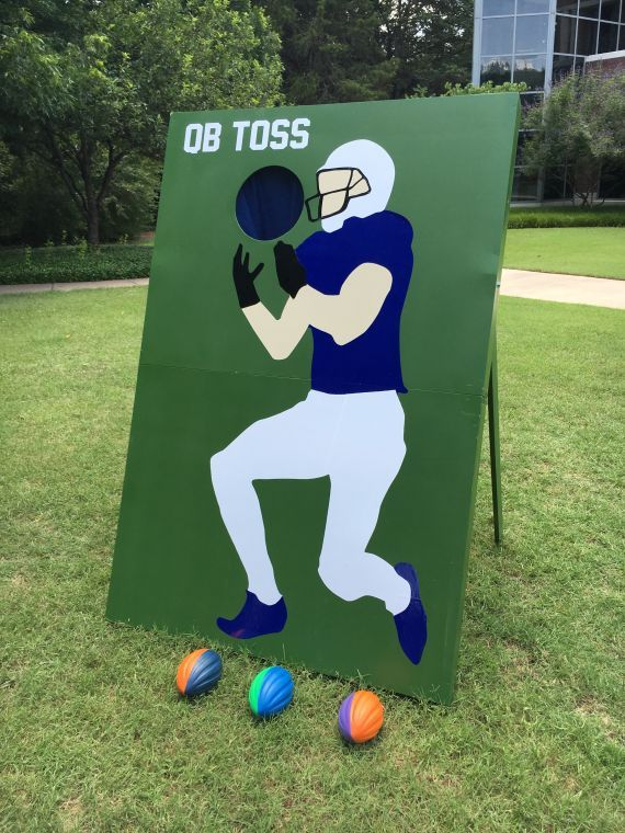 Carnival Games... you could buy one of those large wall vinyl stickers of your favorite football player & apply it to the board ! ... or get a poster size print of a photo of ur favorite quarter back or u could hand paint it ...