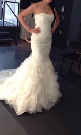 Vera Wang. Of course. Love the style, rouching, flow to the bottom and small train.