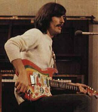 George with his Rocky Stratocaster guitar - he painted it himself - his son Dhani has the guitar today.