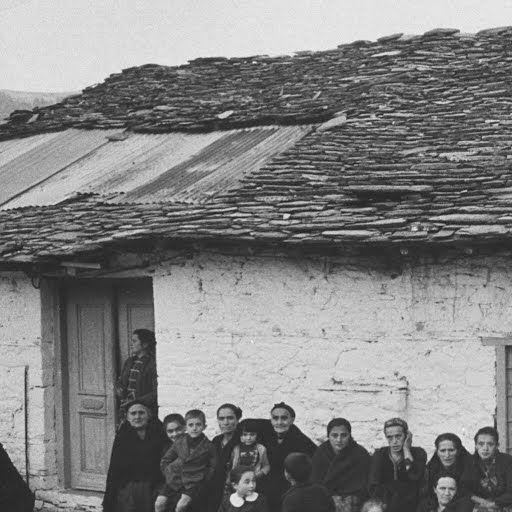 Greek villagers dance in Greek mountain town.