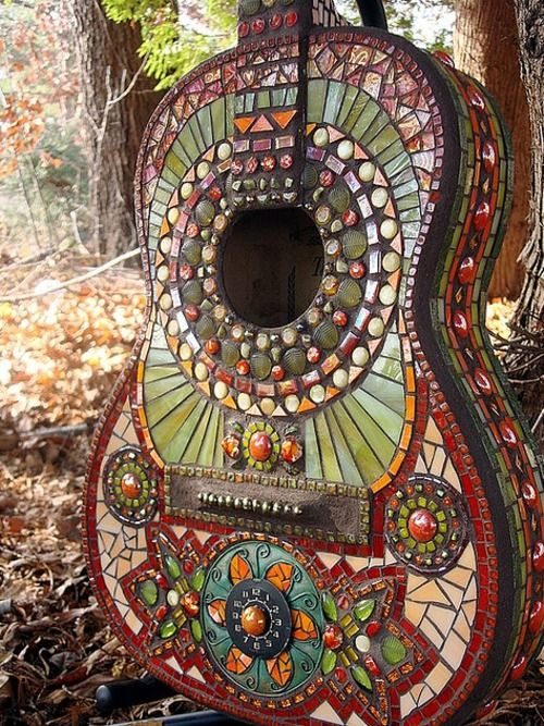 Boho guitar..I want to make something like this for the wall. There are a couple old guitars in the storage room. Wonder if hubby will give them up for art?