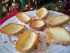Christmas Cookies - Nana's Sandbakkels   One cup of sugar  One cup of soft butter  One egg  ½ teaspoon almond extract  2 ½ cups sifted flour    Cream the sugar and butter. Add egg, flavoring and flour. Pinch off small pieces of dough about the size of a walnut. Press them into the center of a sandbakkel tin, and press thinly and evenly into sides and bottom.