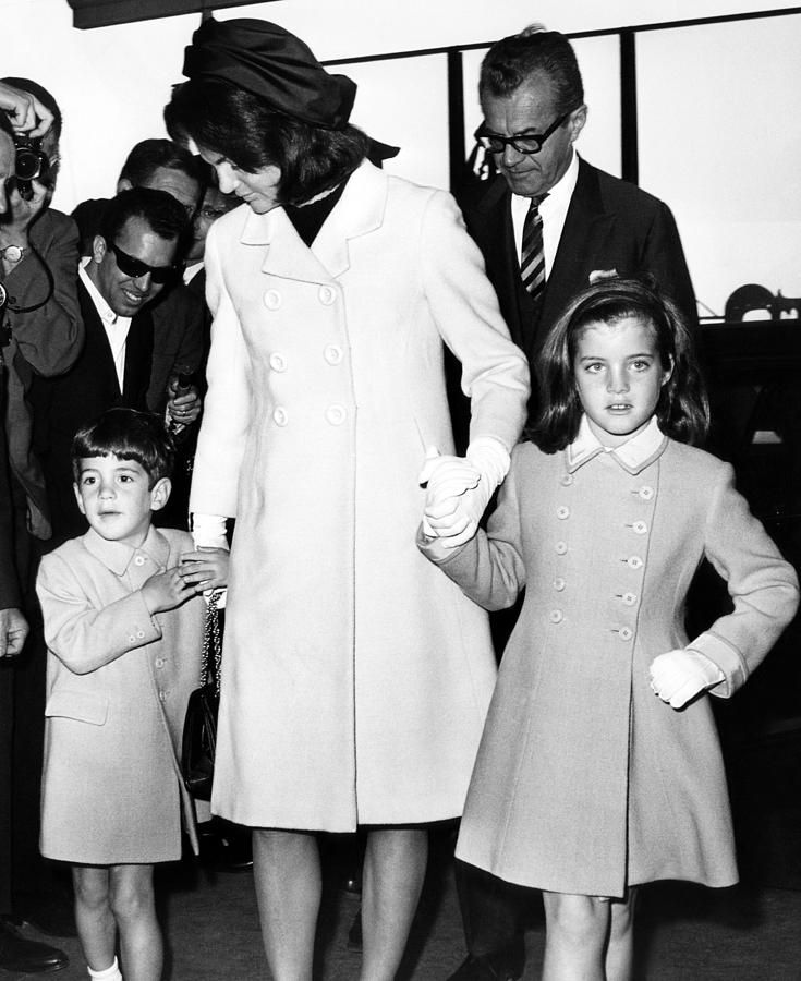 John F. Kennedy Jr., Jacqueline Kennedy, and Caroline Kennedy in the John F. Kennedy International Airport, New York, May 12, 1965.