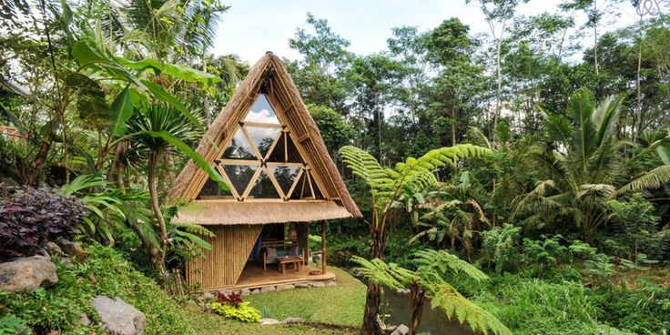 An eco bamboo house on the side of a volcano with riverside rice field views. That's Bali. http://abnb.co/RMvxnV