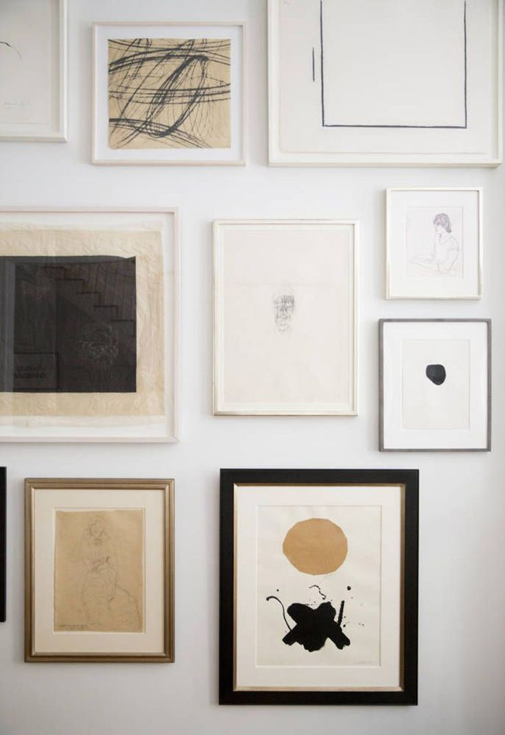 Admired: Haven's Kitchen ownerAli Cayne's simple and refined gallery wallseen on Domino Magazine.Photography by Brittany Ambridge.