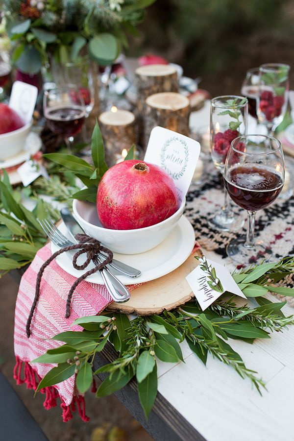 pomegranate place setting, photo by Tyler Rye Photography http://ruffledblog.com/a-desert-christmas-wedding #weddingideas #placesetting