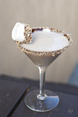 1 1/2 oz marshmallow vodka 3/4 oz white creme de cacao 1/4 oz Kahlua 1 1/2 oz Irish cream chocolate syrup (some for rimming the glass some for the marshmallow) 1/2 sheet of a graham cracker (crushed into little crumbs) 1 big marshmallow