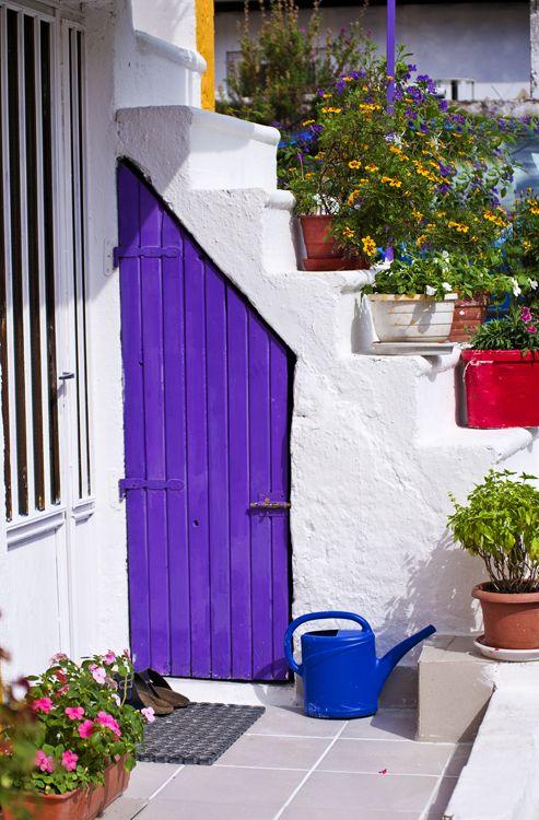 Unusually shaped vivid purple door. Greece