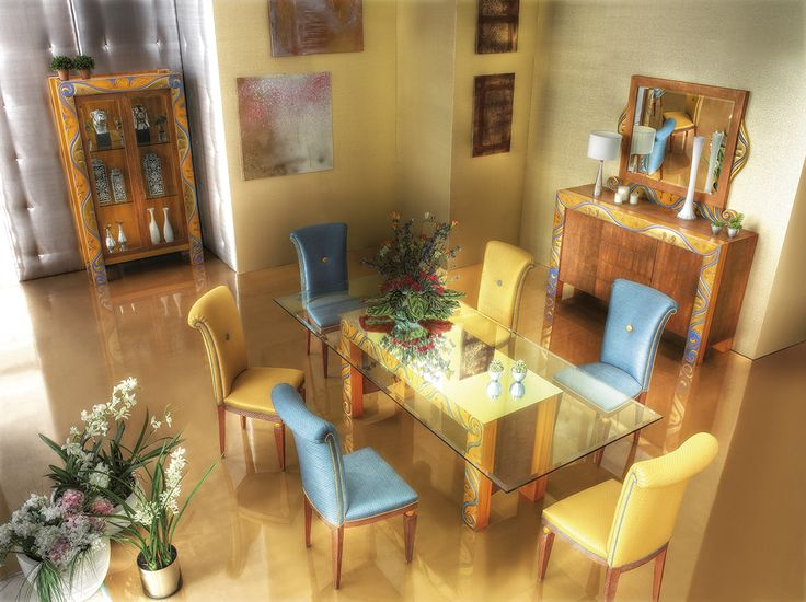 AID   collection Bussy    The warm shades of yellow and orange are combined to the light blue colour in order to make the location elegant and refined. Chairs which have linear shapes and a consolle with less carvings for those who love the classic style but also want to impress with something more contemporary and current.