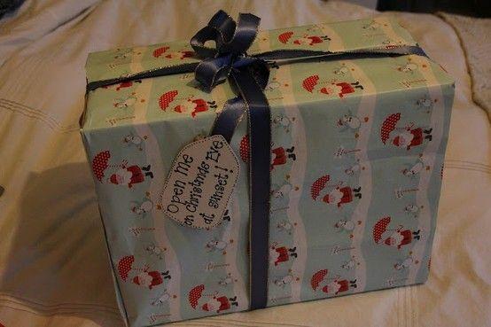 Christmas Eve Box - Include: New pajamas, a Christmas movie, popcorn, mugs, hot chocolate, marshmallows, and a Christmas book. Cute tradition.