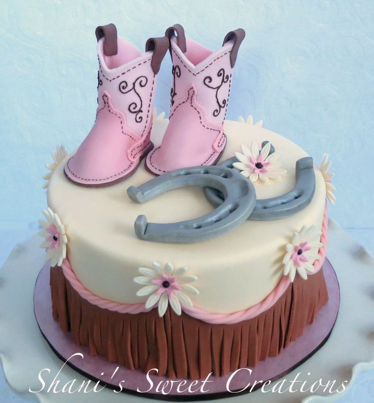 Sweet Baby shower cake with baby cowboy boots, horseshoes and western fringe.