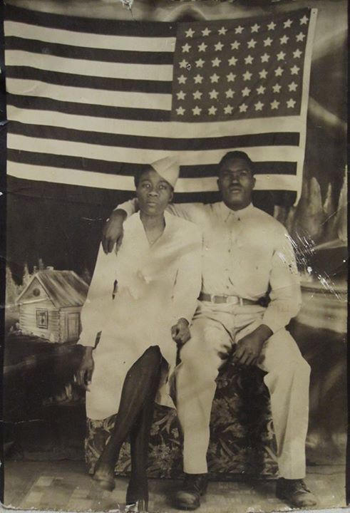 A couple who were both in the military.  The flag is a 48 star flag.