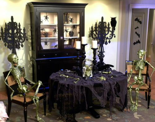 Dining room decorated for halloween love the skeletons for H b bedrooms oldham