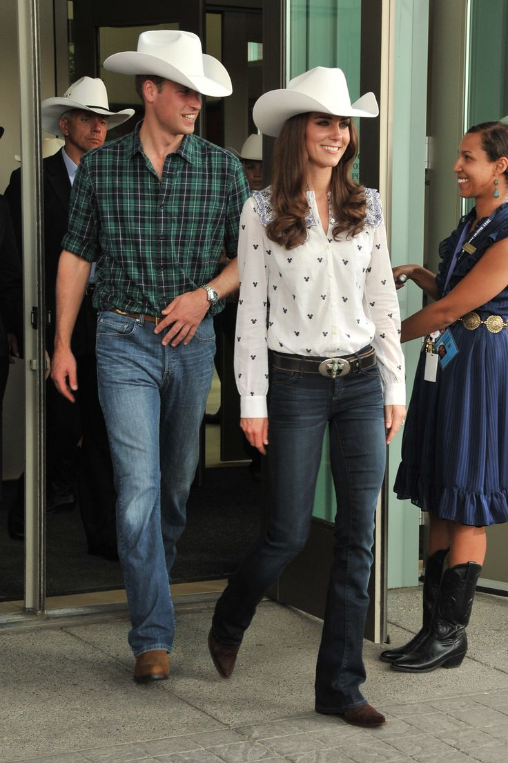 Prince William and Kate Middleton wore matching white cowboy hats to the Calgary Stampede on their royal tour of Canada. Kate completed her cowgirl look with a white button-up, blue jeans, cowboy boots and a belt with turquoise details.