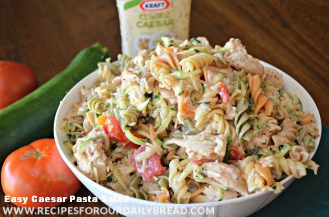 Caesar Chicken Pasta Salad with bacon, tomatoes, zuchinni, and cheese. Like most Healthy foods, this salad is so easy to prepare and truly taste WONDERFUL!