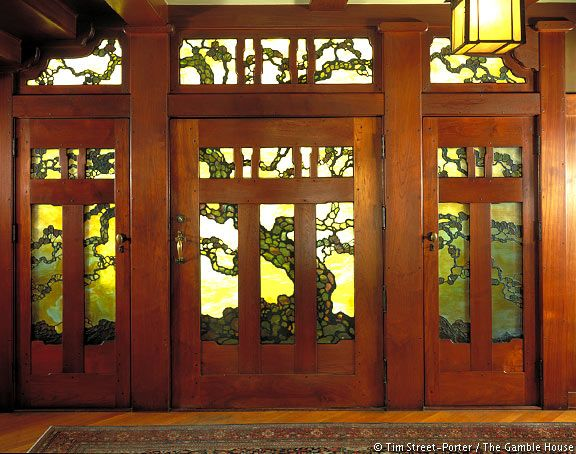 Tree of Life design on the leaded art-glass entry pays homage to the principal material used in the construction of the house.