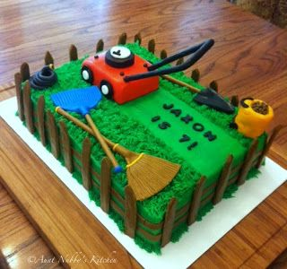 This birthday cake features a lawnmower, shovel, rakes, hose, etc., all in fondant. The lawn mower is shaped from rice krispie treats and straws that have been covered in fondant.