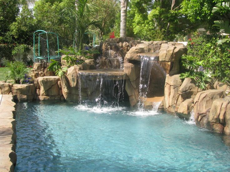 Cool Pools With Waterfalls And Slides this smaller waterfall and slide project has all the elements