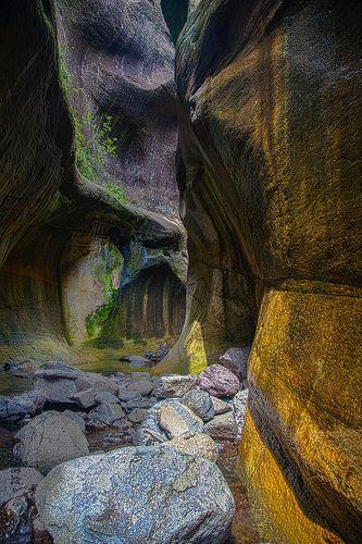 Hiking within the dramatic Drakensberg range of KwaZulu-Natal, South Africa.
