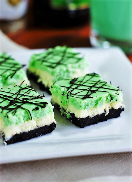 Grasshopper Cheesecake Squares image ~ The classic combination of creme de cacao and creme de menthe with cream {a.k.a. ~ a Grasshopper cocktail} is turned into a beautifully layered cheesecake treat.