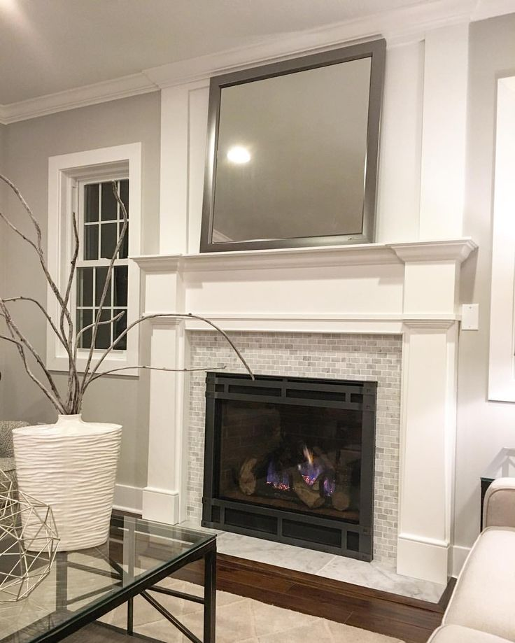 gorgeous white mantel with marble fireplace surround and marble hearth dressed up with custom board