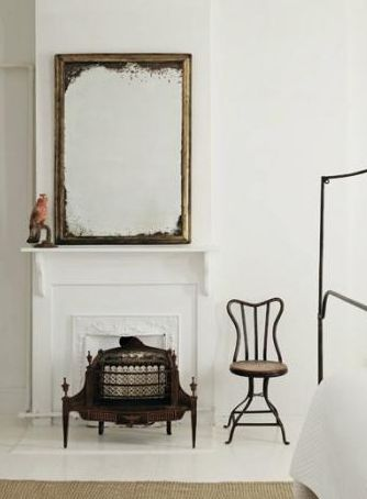 White Washed Room with an Antique Mirror
