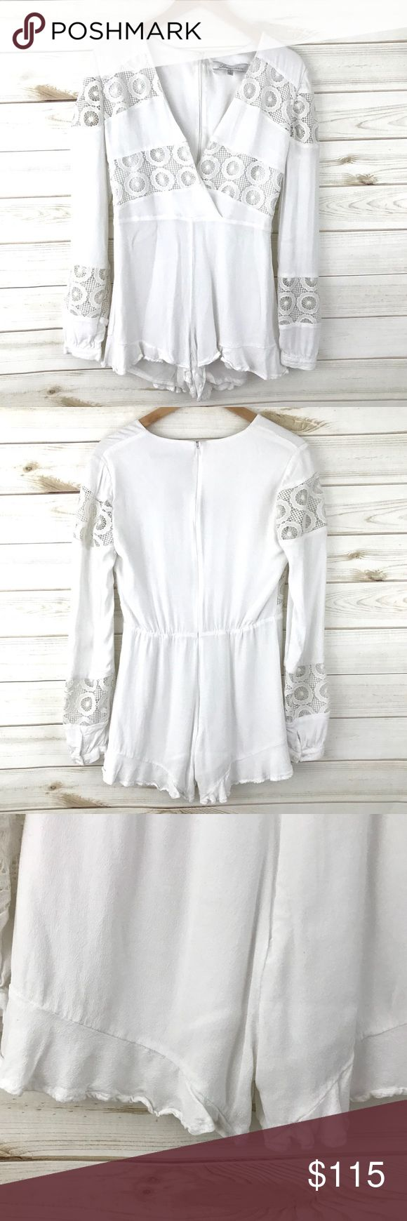 """Lovers + Friends Romper Lovers & Friends white long sleeve romper with lace details. Lined. Hidden back zip. The only flaw is the inside size tag is coming off, but this has never been worn. Bust flat 17"""", inseam 2.5""""  No trades, please - offers and bundles welcome :) Lovers + Friends Pants Jumpsuits & Rompers"""