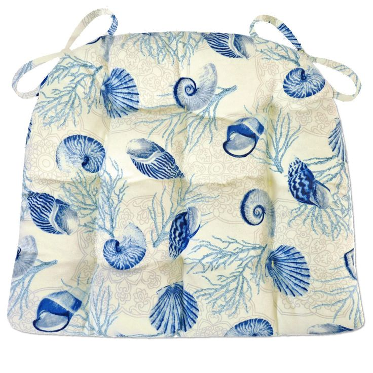 Shell Dance Blue dining chair pads feature realistically portrayed sea shells and coral in shades of blue on an ivory background. -Perfect for a beach house, or any room with a coastal style decor! #blue #white