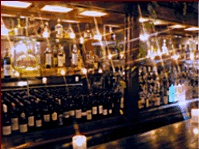 Get a glass of champagne before your romantic meal at St. Martin's French Wine Bistro Main Bar - a little bit of Paris in Dallas.