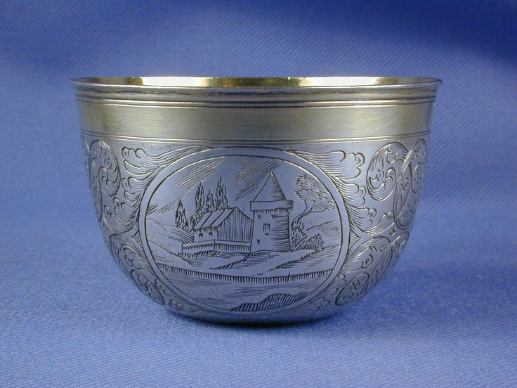 18th century Austrian parcel gilt silver tumbler cup by Johannes Sottenreich, Vienna 1712, gilt band to the reeded rim, gilt interior, engraved to the sides with three architectural scenes and foliate scrolls between