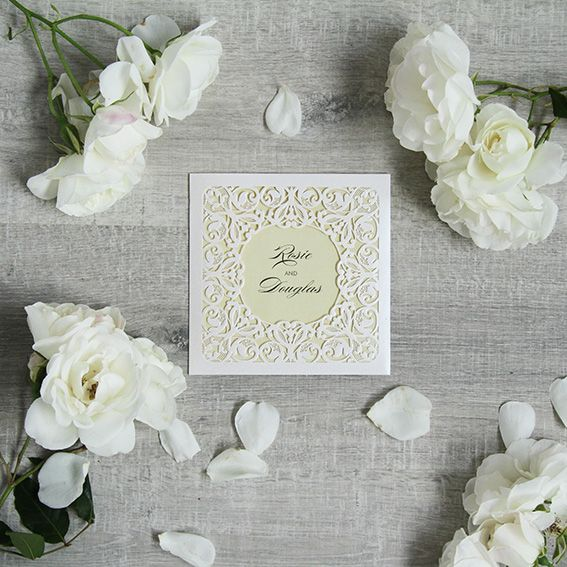 Forever Pearl Essence A simple square cut design surrounded by pearl white swirls. With an elegant and romantic style like this, you cannot go wrong! Main invitations folds open and offers 3 folds for information.