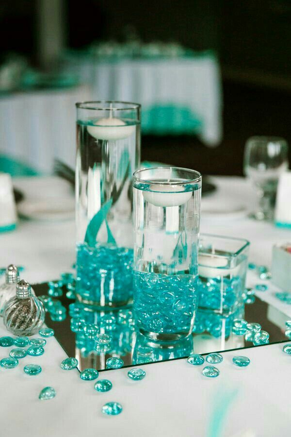 tiffany blue and black wedding decorations%0A Floating candle centerpieces  see rest of article