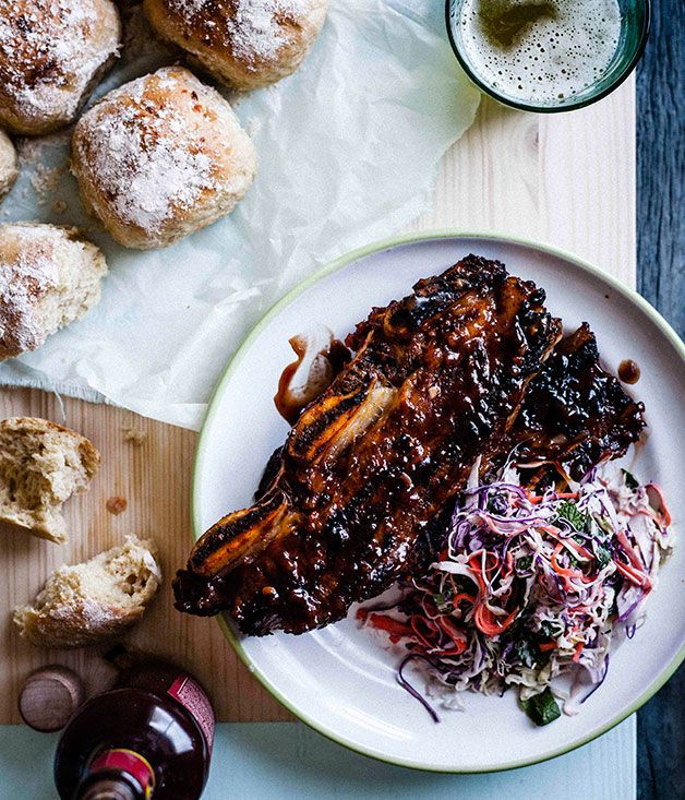 Sticky barbecue beef ribs with coleslaw and soft onion rolls