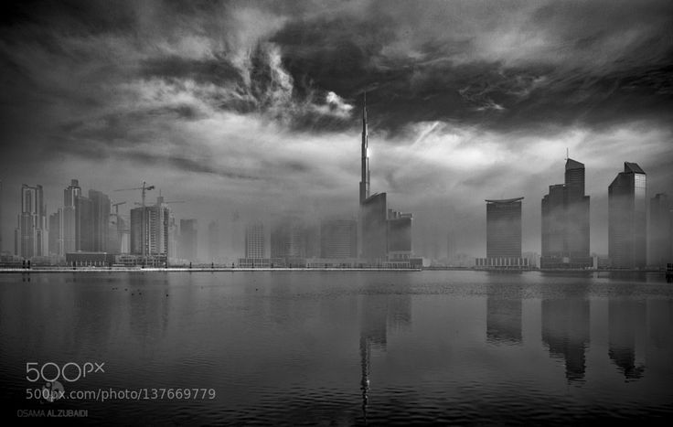 Burj Khalifa in a foggy morning by ozphotos
