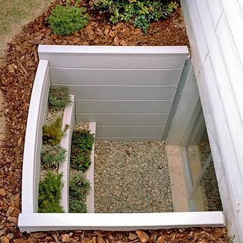Egress Windows - great way to make a practical thing beautiful. Great for a basement suite