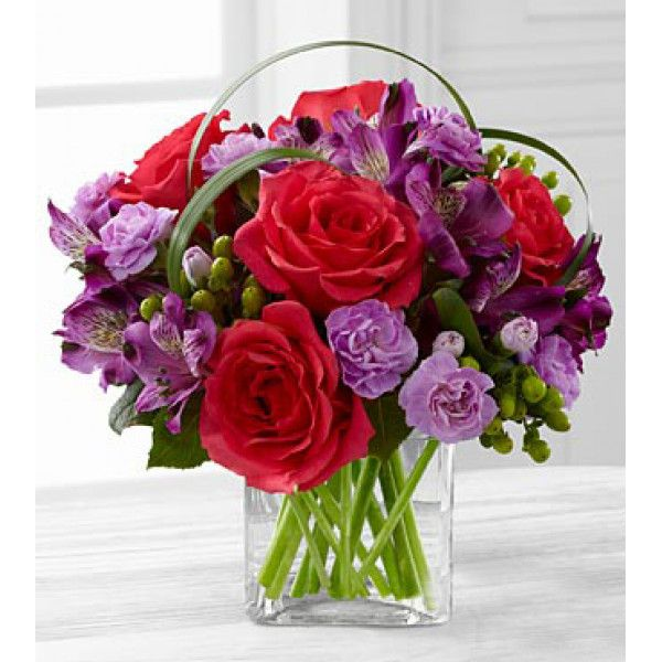The Better Homes and Gardens Be Bold Bouquet. Blooming with bright colors to boldly express your every emotion, this exquisite flower bouquet is set to celebrate. Hot pink roses, purple Peruvian Lilies, lavender mini carnations, green hypericum berries, lily grass blades. Send #Flowers #Online to #Philadelphia