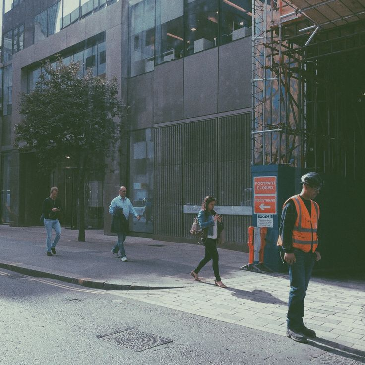 People strolling down the street near to St. Paul's Cathedral, London.