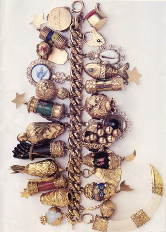 "Jackie Kennedy's Charm Bracelet ""And then the jewels. Left to her own tastes, Jacqueline Kennedy went for the bold and unusual, like the charm bracelet bunched with fish, birds, fruit and a moorish black hand"" http://www.nytimes.com/1996/03/06/sports/06iht-ken.t_0.html"