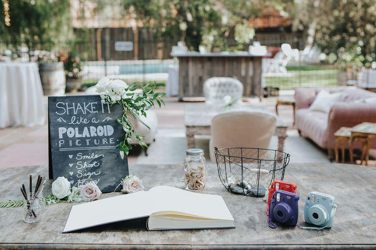 polaroid wedding guest book table