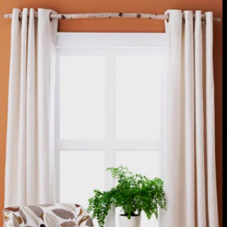 Instead of using curtain rods, give the outdoor-sy look by using a large twig [this is what I am talking about! jh]