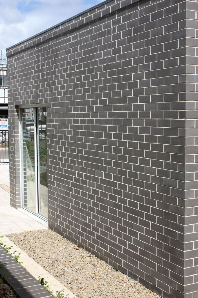 Modern look building using Austral Bricks Ultra Smooth clay brick in Jazz. If I have to have bricks- I want something like this.