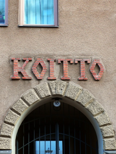 "Katajanokka is principally known for its fine examples of art nouveau architecture. One of these ""jugendstil"" buildings is Koitto at Luotsikatu 18. It was built in 1904 and designed by Oscar Bomarson and Bertel Jung. ""Koitto"" typeface at the wall is a bit clumsy and made of red bricks."
