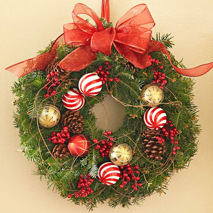 Hang your wreath from a ribbon loop to match the bow making it easy to adjust the display - Admirable christmas wreath decorating ideas to welcome the december ...