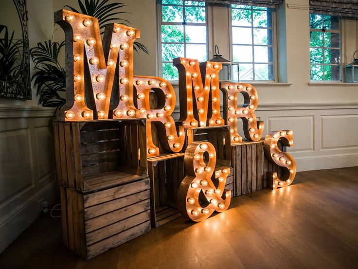 Stunning vintage letter lights presented on authentic vintage apple crates